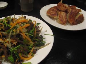 Pan fried dumplings and fried shiitake and coriander Black sesame Beijing