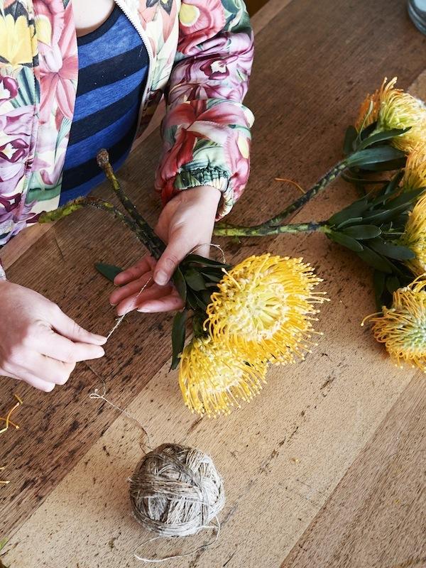 Cecilia Fox Melanie tying flowers by Eve Wilson