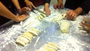 Hands cutting gnocchi final