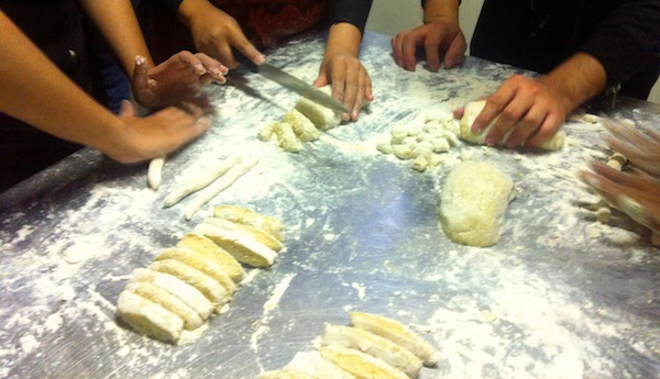 Hands cutting gnocchi final