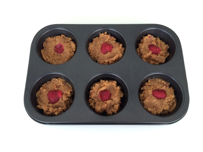 Coconut and Raspberry filled cakes in tin