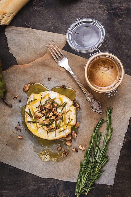Delicious baked camembert with honey, walnuts, herbs and pears