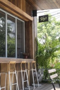 Toby's Cafe sign and chairs Bangkok