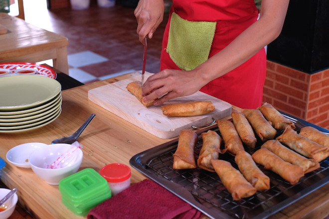 Chiang Mai Thai Farm Cooking School cutting spring rolls