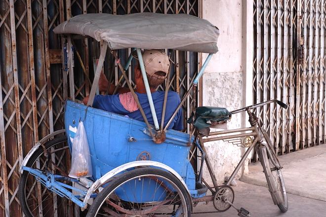 Street Life in Phitsanulok man in rickshaw