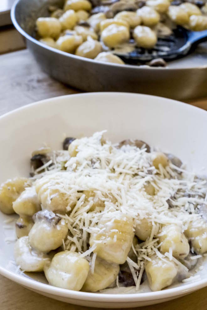 Gnocchi with Creamy Mushroom Sauce Recipe bowl and pan portrait