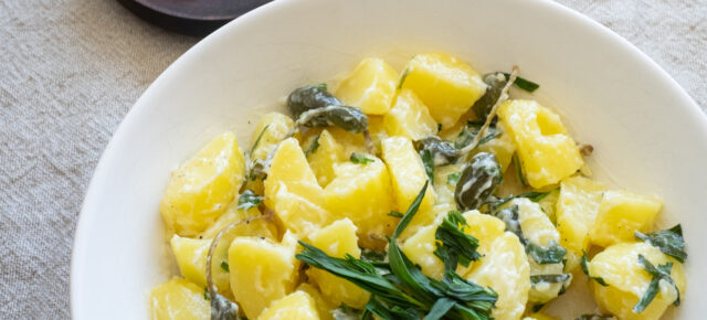 Creamy potato salad with tarragon & caper berries